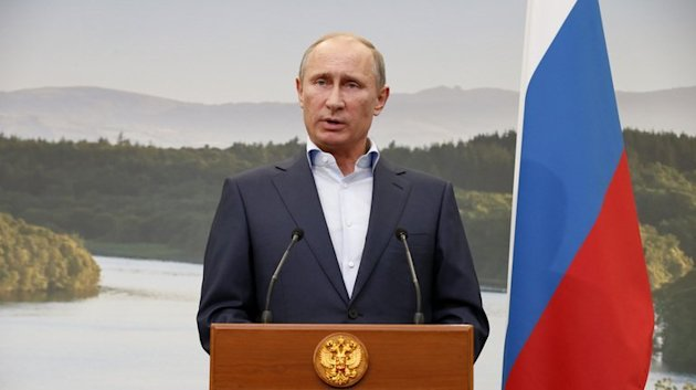 Vladimir Putin speak to the media during the G8 summit at the Lough Erne resort in Northern Ireland on June 18, 2013