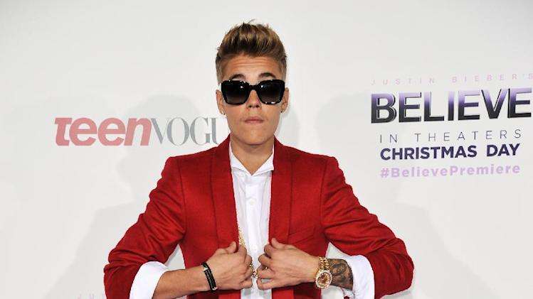 "Justin Bieber arrives at the World Premiere of ""Justin Bieber's Believe"" at Regal Cinemas L.A. Live on Wednesday, Dec. 18, 2013, in Los Angeles. (Photo by Richard Shotwell/Invision/AP)"