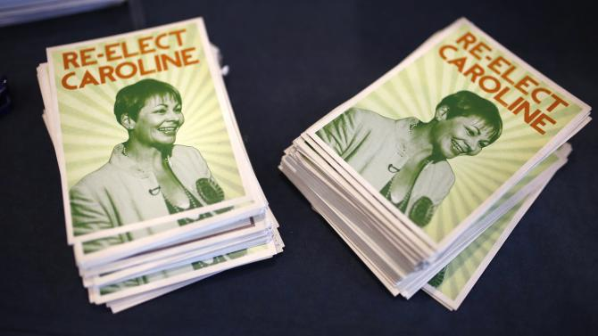 Leaflets in support of the Green Party's only MP, Caroline Lucas, sit on a table on the opening day of the party's spring conference in Liverpool northern England