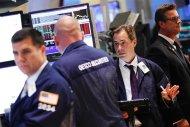 Traders work on the floor of the New York Stock Exchange August 14, 2012. REUTERS/Brendan McDermid