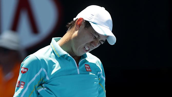 Japan's Kei Nishikori reacts during his fourth round match against Spain's David Ferrer at the Australian Open tennis championship in Melbourne, Australia, Sunday, Jan. 20, 2013. (AP Photo/Dita Alangkara)