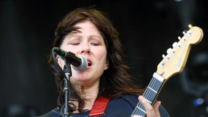 """FILE - This May 17, 2013 file photo shows Kim Deal of The Breeders performing at The Hangout Festival in Gulf Shores, Ala. Deal is no longer a member of the Boston-based group the Pixies. The band announced on its Facebook page Friday that the bassist has decided to leave the group after 25 years. The Pixies' rock hits include """"Monkey Gone to Heaven,"""" """"Here Comes Your Man"""" and """"Letter to Memphis."""" They disbanded in the early 1990s and reunited in 2004. Deal is a part of the band The Breeders, which she formed and performs as lead singer and guitarist. (Photo by John Davisson/Invision/AP, file)"""
