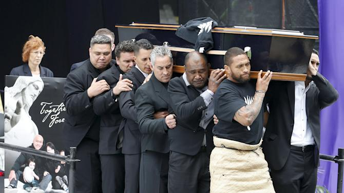 Former All Black Jonah Lomu's casket is carried out of Eden Park during his memorial service in Auckland