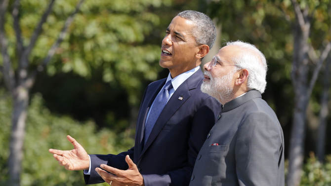 U.S. President Barack Obama and India's Prime Minister Narendra Modi talk at the National Martin Luther King Memorial on the National Mall in Washington