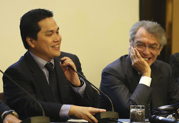 Inter Milan newly elected President Erick Thohir, left, sits next to outgoing President Massimo Moratti in Milan, Italy, Friday, Nov. 15, 2013. Inter Milan owner Erick Thohir has been elected as club