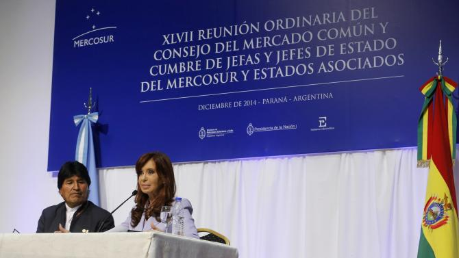 Bolivia's President Morales and his Argentine counterpart Fernandez de Kirchner attend a bilateral meeting after MERCOSUR summit in Parana