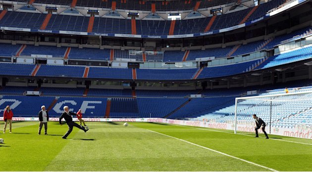 A member of the IOC evaluation commission shoots a penalty to Casillas, captain of Real Madrid and Spanish national soccer team, during a visit to Madrid's Santiago Bernabeu stadium