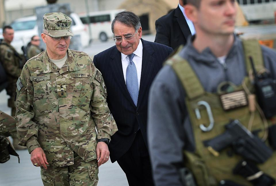 Defense Secretary Leon Panetta talks with Lt. Gen. Curtis Scaparrotti in Kabul, Afghanistan, Thursday, March 15, 2012, before leaving for United Arab Emirates.  (AP Photo/Scott Olson, Pool)