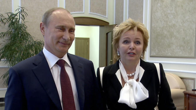 "In this grab made from video provided by the Russia24 TV Channel on Thursday, June 6, 2013, Russian President Vladimir Putin, left, and his wife Lyudmila speak to journalists after attending the ballet ""La Esmeralda"" in the Kremlin Palace in Moscow, Russia. Russian President Vladimir Putin and his wife Lyudmila said Thursday they are divorcing after nearly 30 years of marriage, making the announcement on state television after attending a ballet performance at the Kremlin. (AP Photo/Russia24 via The Associated Press Television News) TV OUT"