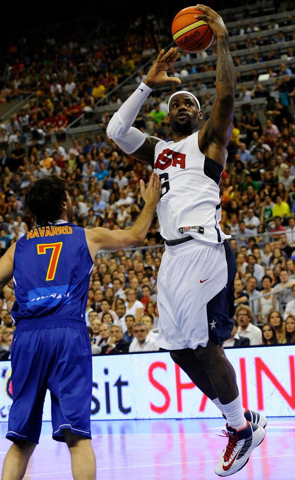 LeBron James of the US Men's Senior National Team, right, jumps for the ball against Juan Carlos Navarro, left, of Spain Men's Senior National Team during an exhibition match between Spain and the United States Tuesday, July 24, 2012, in Barcelona, Spain, in preparation for the 2012 Summer Olympics. (AP Photo/Manu Fernandez)