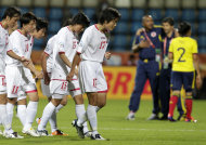 North Korean players walk off the pitch following the group C match between North Korea and Colombia at the Women's Soccer World Cup in Bochum, Germany, Wednesday, July 6, 2011. (AP Photo/Yves Logghe)