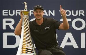 Stenson of Sweden poses with his 2013 Race to Dubai trophy after winning the DP World Tour Championship in Dubai