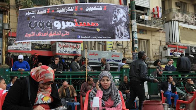 Egyptians sit in makeshift street cafe in Tahrir Square, Cairo, Egypt, Friday, Jan. 25, 2013. Egyptian opposition protesters are gathering in Cairo's Tahrir Square to mark the second anniversary of the uprising that toppled Hosni Mubarak's autocratic regime. Arabic  (AP Photo/Thomas Hartwell)