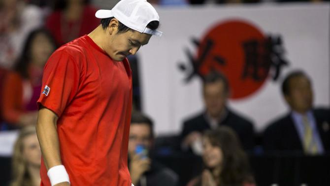 Japan's Ito reacts after falling in straight sets to Canada's Raonic during their Davis Cup tennis match at Doug Mitchell Thunderbird Sports Centre in Vancouver, British Columbia.