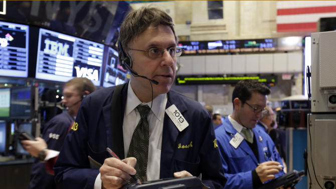 Trader Joseph Chirico, center, works on the floor of the New York Stock Exchange Friday, Dec. 21, 2012. Stocks opened sharply lower Friday on Wall Street after House Republicans called off a vote on tax rates and left federal budget talks in disarray 10 days before sweeping tax increases and government spending cuts take effect. (AP Photo/Richard Drew)
