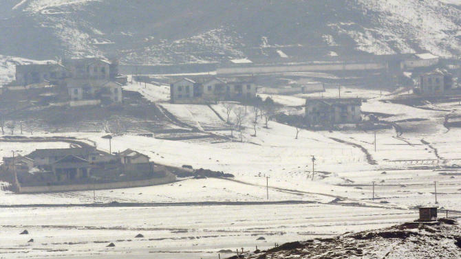 A North Korean military guard post, right bottom, in North Korea's Kaepoong is viewed from the unification observation post near the border village of Panmunjom, that has separated the two Koreas since the Korean War, in Paju, north of Seoul, South Korea, Wednesday, Feb. 13, 2013. North Korea's neighbors bolstered their military preparations and mobilized scientists Wednesday to determine whether Pyongyang's third nuclear test, conducted in defiance of U.N. warnings, was as successful as the North claimed. (AP Photo/Lee Jin-man)