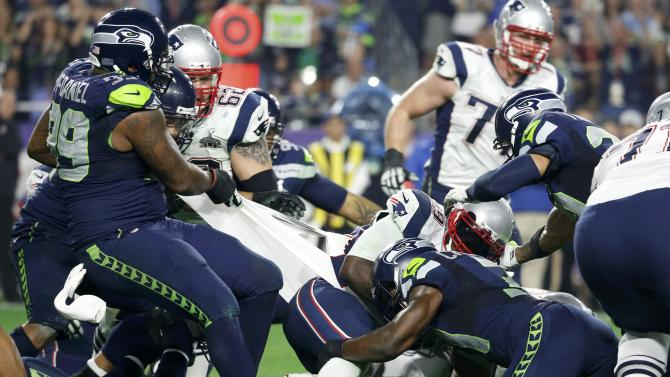 Seattle Seahawks defensive tackle McDaniel holds the jersey of New England Patriots running back Blount to make a second half stop during the NFL Super Bowl XLIX football game in Glendale