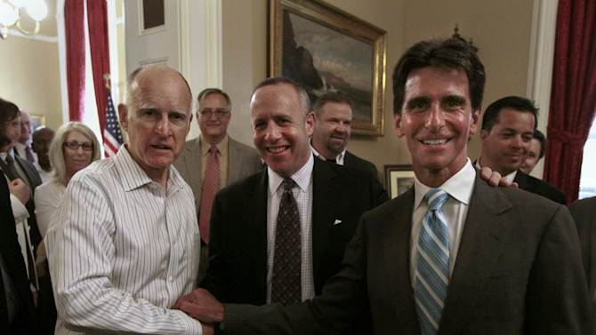Gov. Jerry Brown, left, Senate President Pro Tem Darrell Steinberg, D-Sacramento, center, and Sen. Mark Leno, D-San Francisco, chair of the Senate Budget Committee smile for the camera after the Senate approved  funding for a high-speed rail system at the Capitol in Sacramento, Calif., Friday, July 6, 2012.   The bill, which would allow the state to begin selling $2.6 billion in voter-approved bonds, was approved by a 21-16 vote.(AP Photo/Rich Pedroncelli)