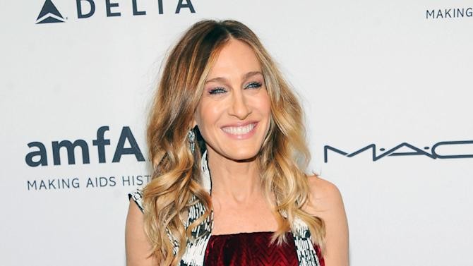 """FILE - This Feb. 6, 2013 file photo shows actress Sarah Jessica Parker at amfAR's New York gala at Cipriani Wall Street in New York. AOL is making its most substantial dip into original video programming with new series with Sarah Jessica Parker, Gwyneth Paltrow, Hank Azaria and Nicole Richie. The Internet company unveiled 15 new digital series Tuesday, April 30, in a presentation to advertisers in New York. AOL is making a push into original programming in the wake of similar efforts by YouTube, Yahoo and Amazon.  Parker will produced a docudrama on the New York City Ballet titled """"City.Ballet."""" Paltrow and Tracy Anderson will host the Ryan Seacrest-produced series """"Second Chances,"""" in which they interview women who've overcome hardship.  (Photo by Evan Agostini/Invision/AP, file)"""