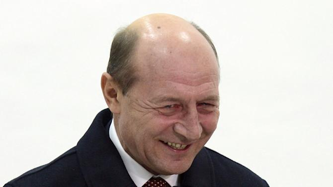 Romania's President Traian Basescu, casts  his vote in Bucharest, Romania, Sunday, Dec. 9, 2012. Millions of Romanians braved rain and snow Sunday as they went to the polls for a parliamentary election that center-left government is expected to win a, but the result could lead to more of the political instability that has plagued the impoverished Balkan nation this year. (AP Photo)