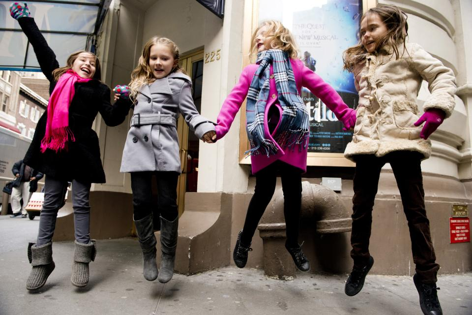 "Actresses from left, Bailey Ryon, Sophia Gennusa, Milly Shapiro and Oona Laurence, who will share the title role in ""Matilda the Musical"" on Broadway, pose for a portrait outside the Shubert Theatre, on Thursday, Nov. 15, 2012 in New York. (Photo by Charles Sykes/Invision/AP)"