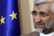 Iran's Supreme National Security Council Secretary and chief nuclear negotiator Saeed Jalili smiles before talks in Almaty February 26, 2013. World powers began talks with Iran on its nuclear programme in the Kazakh city of Almaty on Tuesday, in a fresh attempt to resolve a decade-old standoff that threatens the Middle East with a new war. REUTERS/Stanislav Filippov/Pool