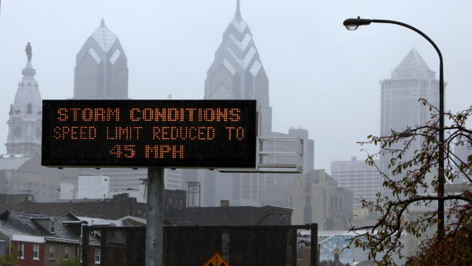 A warning sign displays a directive near downtown Philadelphia ahead of Hurricane Sandy's landfall Monday, Oct. 29, 2012. Hurricane Sandy continued on its path Monday, as the storm forced the shutdown of mass transit, schools and financial markets, sending coastal residents fleeing, and threatening a dangerous mix of high winds and soaking rain. (AP Photo/Jacqueline Larma)