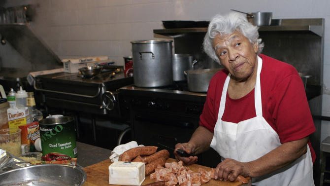 """FILE - In this Jan. 20, 2009 file photo, Chef Leah Chase, owner of Dooky Chase Restaurant, prepares a meal in the kitchen of her restaurant in New Orleans. Dooky Chase Restaurant is one of the few civil rights landmarks remaining in New Orleans. """"I feel like in this restaurant, we changed the course of the world over bowls of gumbo."""" (AP Photo/Bill Haber, File)"""