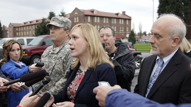 Emma Scanlan, center, the civilian defense attorney for U.S. Army Staff Sgt. Robert Bales, talks to reporters, Tuesday Nov. 13, 2012, as she stands with Bales' military defense attorney, Maj. Gregory Malson, second from left, and attorney Lance Rosen, right, on Joint Base Lewis McChord in Washington state, where a preliminary hearing ended Tuesday for Bales, who is accused of 16 counts of premeditated murder and six counts of attempted murder for a pre-dawn attack on two villages in Kandahar Province in Afghanistan last March. (AP Photo/Ted S. Warren)