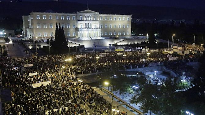 Protesters gather in front of the parliament in Athens on Wednesday Nov. 7, 2012. Greece's fragile coalition government faces its toughest test so far when lawmakers vote later Wednesday on new painful austerity measures demanded to keep the country afloat, on the second day of a nationwide general strike. The euro13.5 billion ($17.3 billion) package is expected to scrape through Parliament, following a hasty one-day debate. But potential defections could severely weaken the conservative-led coalition formed in June with the intention of keeping Greece in the euro.(AP Photo/Dimitri Messinis)