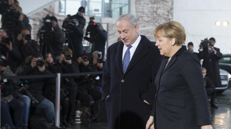 German Chancellor Angela Merkel, right, welcomes the Prime Minister of Israel, Benjamin Netanyahu at the chancellery Berlin, Thursday, Dec. 6, 2012. It was supposed to be an amicable meeting between close friends. Instead, Israeli Prime Minister Benjamin Netanyahu's visit to Germany has been soured by Berlin's refusal to oppose a Palestinian U.N. statehood bid and anger throughout Europe over Israeli plans to expand settlements around Jerusalem. (AP Photo/Markus Schreiber)