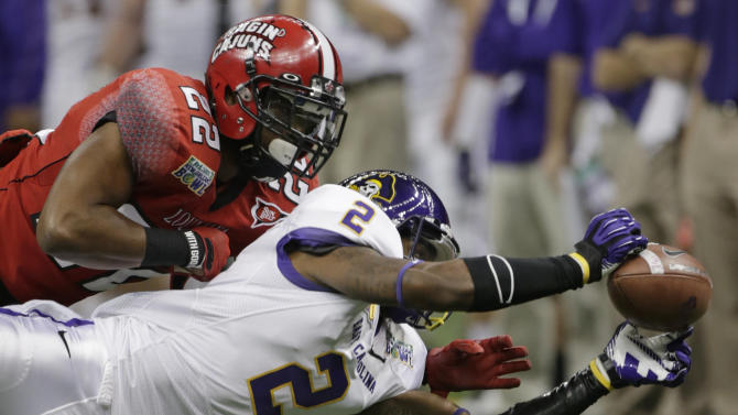 Louisiana-Lafayette cornerback Melvin White (22) breaks up a pass to East Carolina wide receiver Justin Hardy (2) in the first half of the New Orleans Bowl, an NCAA college football game in New Orleans, Saturday, Dec. 22, 2012. (AP Photo/Dave Martin)