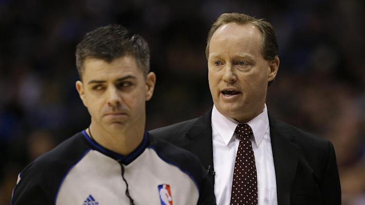 Referee Eli Roe, left, walks away as San Antonio Spurs acting coach Mike Budenholzer, right, complains about a play against the Dallas Mavericks in the first half of an NBA basketball game on Friday, Jan. 25, 2013, in Dallas. Spurs head coach Greg Popovich was absent from the game.  (AP Photo/Tony Gutierrez)