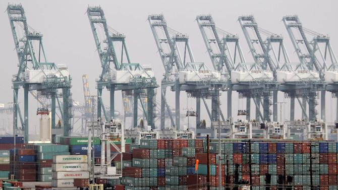 Shipping containers are seen as port operations are halted during a strike at the Port of Los Angeles Tuesday, December 4,  2012. Los Angeles Mayor Antonio Villaraigosa says both sides in a strike at the twin ports of Los Angeles and Long Beach have agreed to federal mediation. However, the union representing clerical workers says the strike now in its eighth day will continue. Clerical workers are striking 10 terminals at the nation's busiest port complex and dockworkers won't cross picket lines.  (AP Photo/Nick Ut)