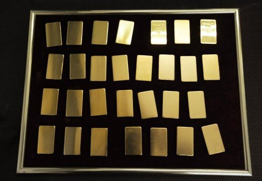 <p>A tray of 100-gram gold bars pictured in 2008. A similar windfall of gold ingots was found by two council workers in Switzerland in June. If the ingots are not claimed within five years, reports Thursday said, the workers will be allowed to keep the unexpected windfall.</p>