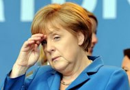 German Chancellor Angela Merkel gestures during the last campaign meeting of her ruling party CDU candidate for the elections in North Rhine-Westphalia (NRW) state in Duesseldorf on May 11. Voters in a crucial German state emphatically punished Merkel&#39;s pro-austerity party Sunday, awarding her main centre-left rivals a major boost ahead of 2013 national elections