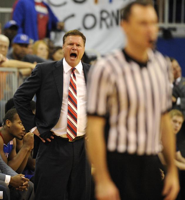 Bill Self, head coach for the University of Kansas has words for the official during the second half of an NCAA college basketball game against Florida Tuesday, Dec. 10, 2013 in Gainesville, Fla. Flor