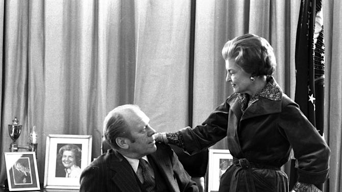 FILE - In this Jan. 19, 1977 file picture, President Gerald Ford and first lady Betty Ford pause for a moment as they continue packing at the White House in Washington. On Friday, July 8, 2011, a family friend said that Betty Ford had died at the age of 93. (AP Photo/Eddie Adams)