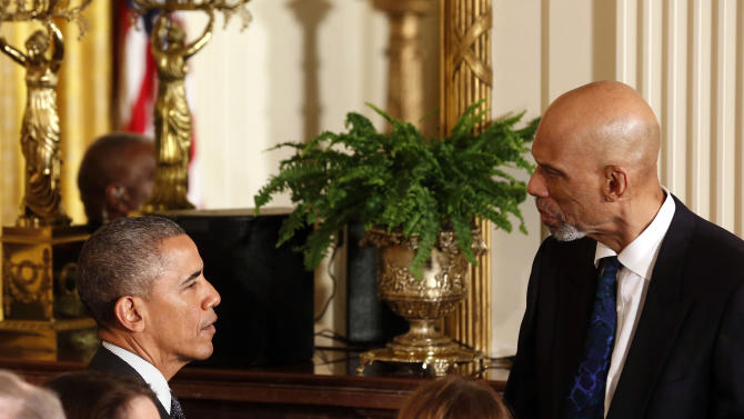 Obama greets NBA star Kareem Abdul-Jabbar after he makes remarks highlighting investments to improve health and treat disease through precision medicine while in the East Room of the White House in Washington