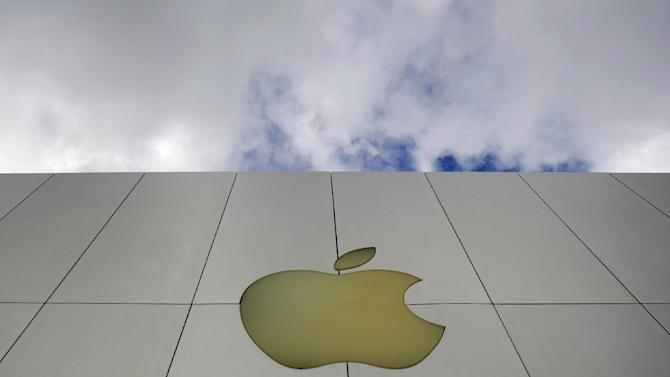 FILE - In this Oct. 19, 2009 file photo, the Apple logo is seen on an Apple store in San Francisco. AP Apple shares plunged Thursday, Jan. 24, 2013, after the company reported quarterly results that point to growth slowing after five blowout years. (AP Photo/Russel A. Daniels, File)
