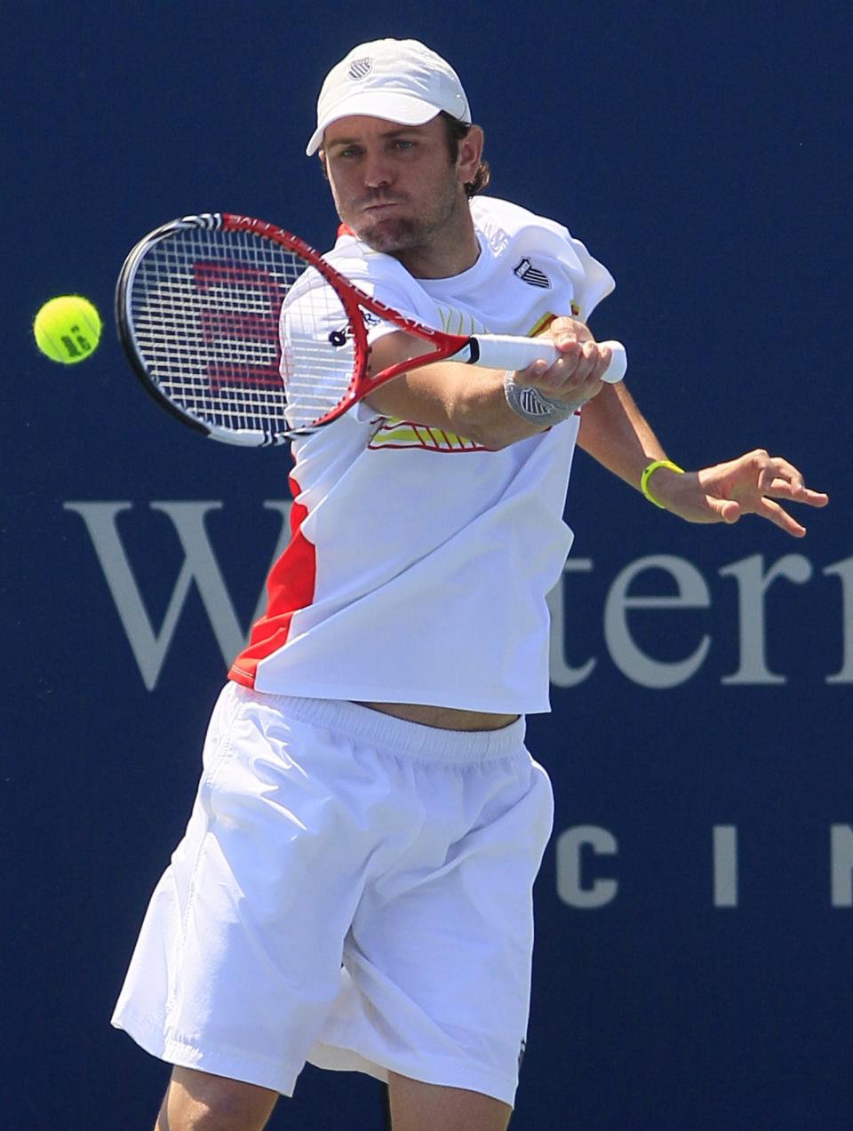 Mardy Fish hits a forehand shot against Radek Stepanek, from the Czech Republic, during a match at the Western & Southern Open tennis tournament, Thursday, Aug. 16, 2012, in Mason, Ohio. (AP Photo/Al Behrman)