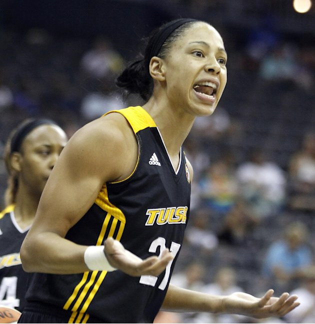 File- This July 17, 2011 file photo shows Tulsa Shock forward Jennifer Lacy reacting after being called for a foul against the New York Liberty during the first quarter of a WNBA basketball game, Sund