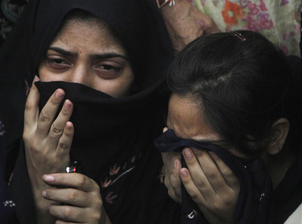 Family members of the allegedly executed boy mourn his death in Karachi, Pakistan on Thursday, June 9, 2011. Pakistani authorities are investigating a video that appears to show paramilitary forces shooting to death an unarmed teenage boy in the southern port city of Karachi, officials said Thursday. (AP Photo/Shakil Adil)