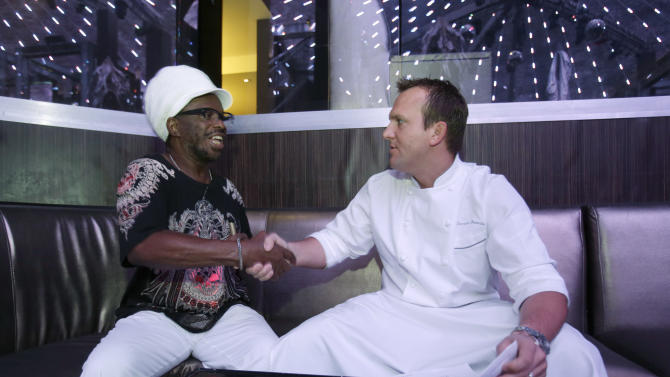 In this Monday, Oct. 6, 2014 photo, Derrick Roberts, right, Chef De Cuisine at Gotham Steak restaurant at Fontainebleau Miami Beach, shakes hands with job seeker Robert Rouse after an interview during a job fair at the Fontainebleau in Miami Beach, Fla. The Commerce Department releases third-quarter gross domestic product on Thursday, Oct. 30, 2014. (AP Photo/Wilfredo Lee)