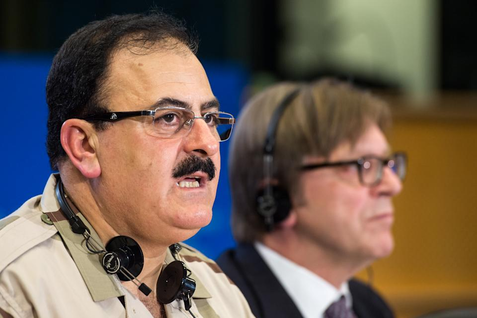 Chief of Staff of the Free Syrian Army Gen. Salim Idris addresses the media after he discussed the situation in Syria with the leader of the Group of the Alliance of Liberals and Democrats for Europe Guy Verhofstadt, right, at the European Parliament in Brussels, Wednesday March 6, 2013.  (AP Photo/Geert Vanden Wijngaert)