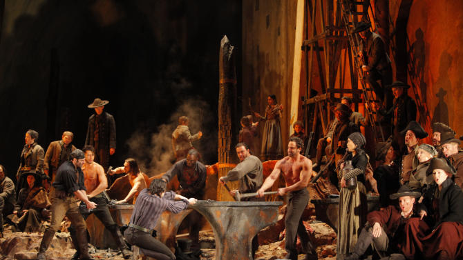 "This Feb. 13, 2009  production photo provided by the Metropolitan Opera shows a scene from Verdi's ""Il Trovatore"" at the Metropolitan Opera in New York. The current revival of David McVicar's fast-moving, Goyaesque production, which starred soprano Angela Meade as Lenora on Wednesday, Jan 16, 2013, had already been seen during the season's opening week, but with an entirely different cast. The only holdover was conductor Daniele Callegari, who brought more energy and drive to the score than he had back in September. (AP Photo/Metropolitan Opera, Ken Howard)"