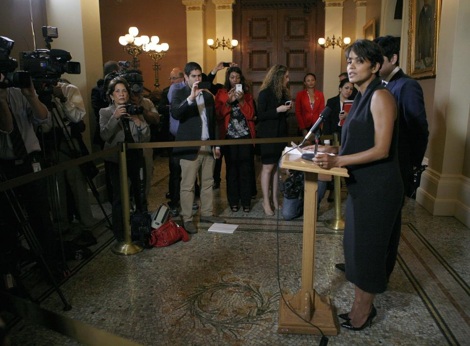 Actress Halle Berry, right, talks with reporters at a news conference before testifying at an Assembly Committee on Public Safety hearing for a bill that would limit the ability of paparazzi to photograph the children of celebrities and public figures at the Capitol in Sacramento, Calif., on Tuesday, June 25, 2013. (AP Photo/Steve Yeater)