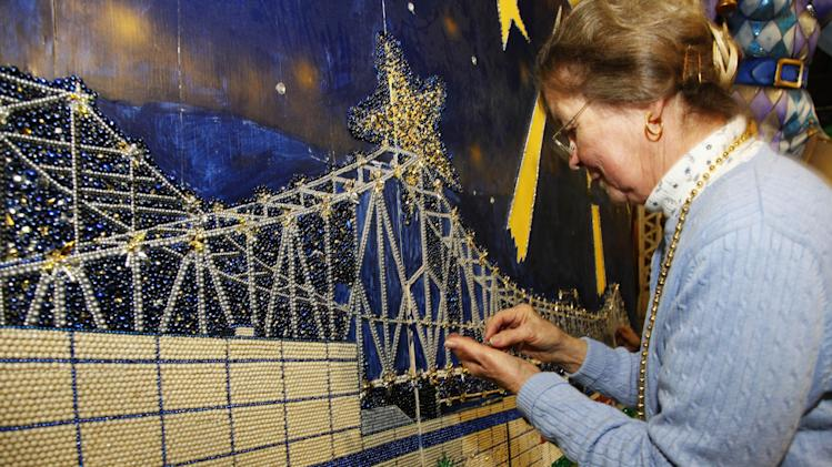 "This Jan. 14, 2013 photo shows volunteer Gail Dusenberry of Clyde, North Carolina working on Artist Stephan Wanger""s bead mosaic ""Paragons of New Orleans"" at Mardi Gras World in New Orleans. Super Bowl takes place in New Orleans on Feb. 3 and Mardi Gras falls nine days later on Feb. 12. With both events so close together, New Orleans is bracing for a massive celebration and record crowds.  (AP Photo/Bill Haber)"