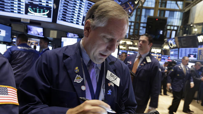 Trader Warren Meyers on the floor of the New York Stock Exchange Wednesday, Sept. 18, 2013.  Stocks were little changed in early trading Wednesday as investors wait to hear from the Federal Reserve on the fate of the central bank's bond-buying program. (AP Photo/Richard Drew)