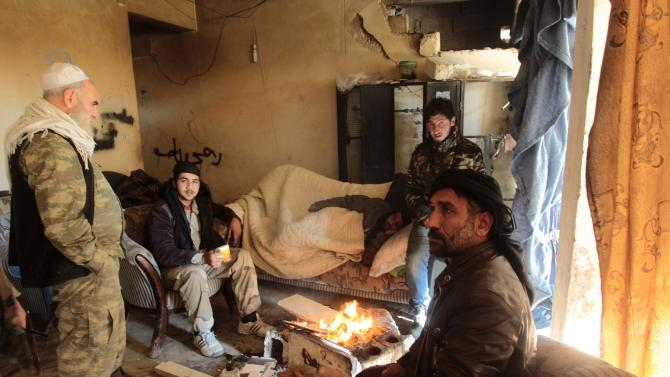 Free Syrian Army fighters rest in a safe house on Breij frontline in Old Aleppo